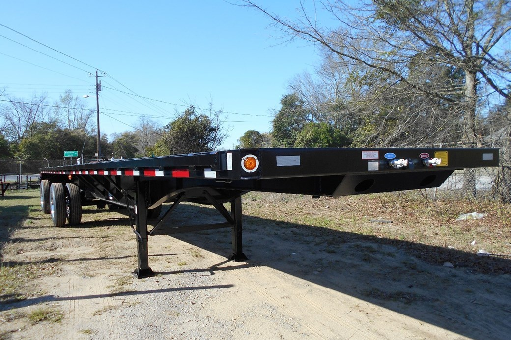 The 42' flatbed has retractable twistlocks in order to carry 40' ISO containers